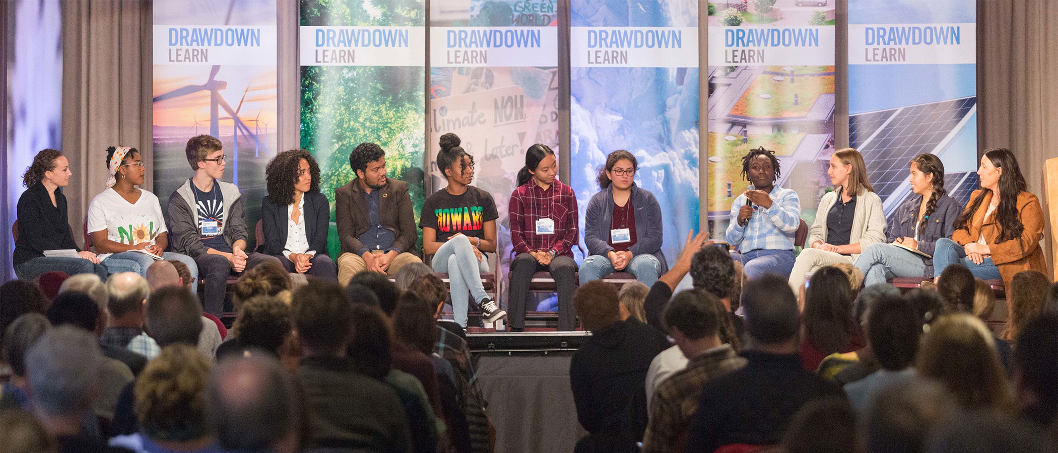 A panel of students on stage discussing climate solutions at the Drawdown Learn conference