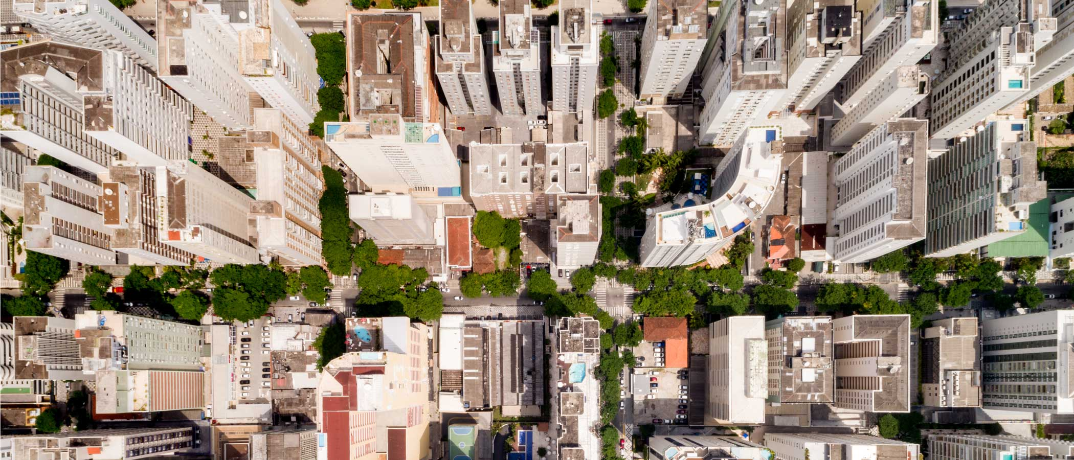 Aerial view of an urban residential neighborhood with apartment towers, courtyards, and open space.