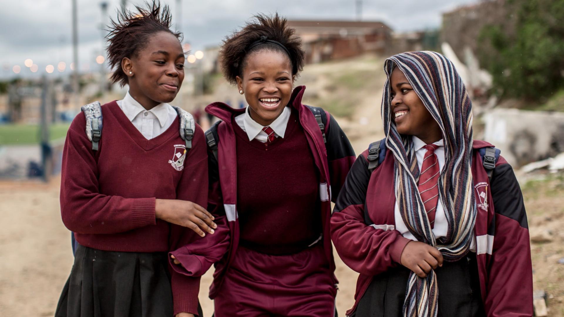 Three school-age girls walking
